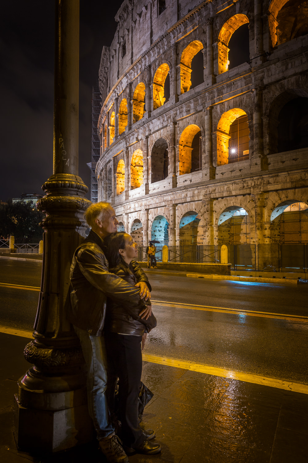 Canoodling at the Roman Coliseum. We got lucky because it was a rainy night which shined up the road. And then the headlights from a bus down the street illuminated out faces.