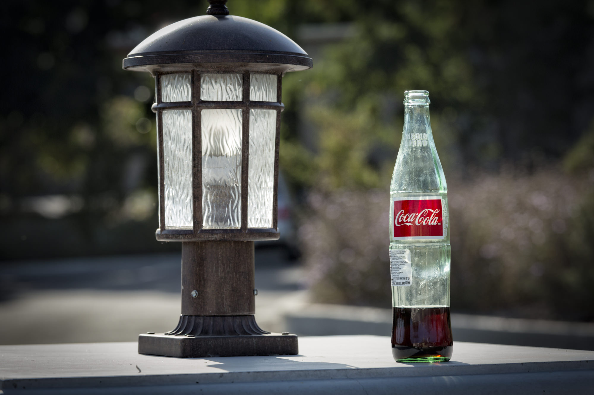 Someone left this nearly empty bottle next to a light and the mundane became an interesting juxtaposition of objects.