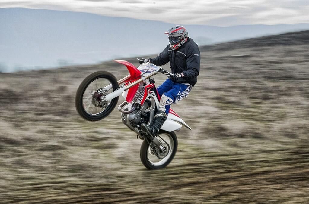 Panning image of motocross rider: ISO-800, f/25, 1/100 sec.