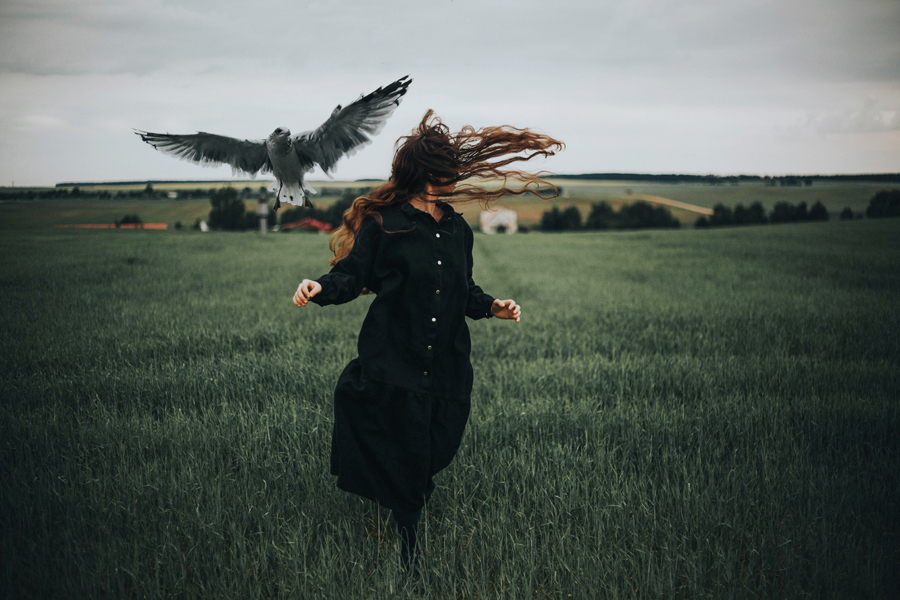 girl running away with bird