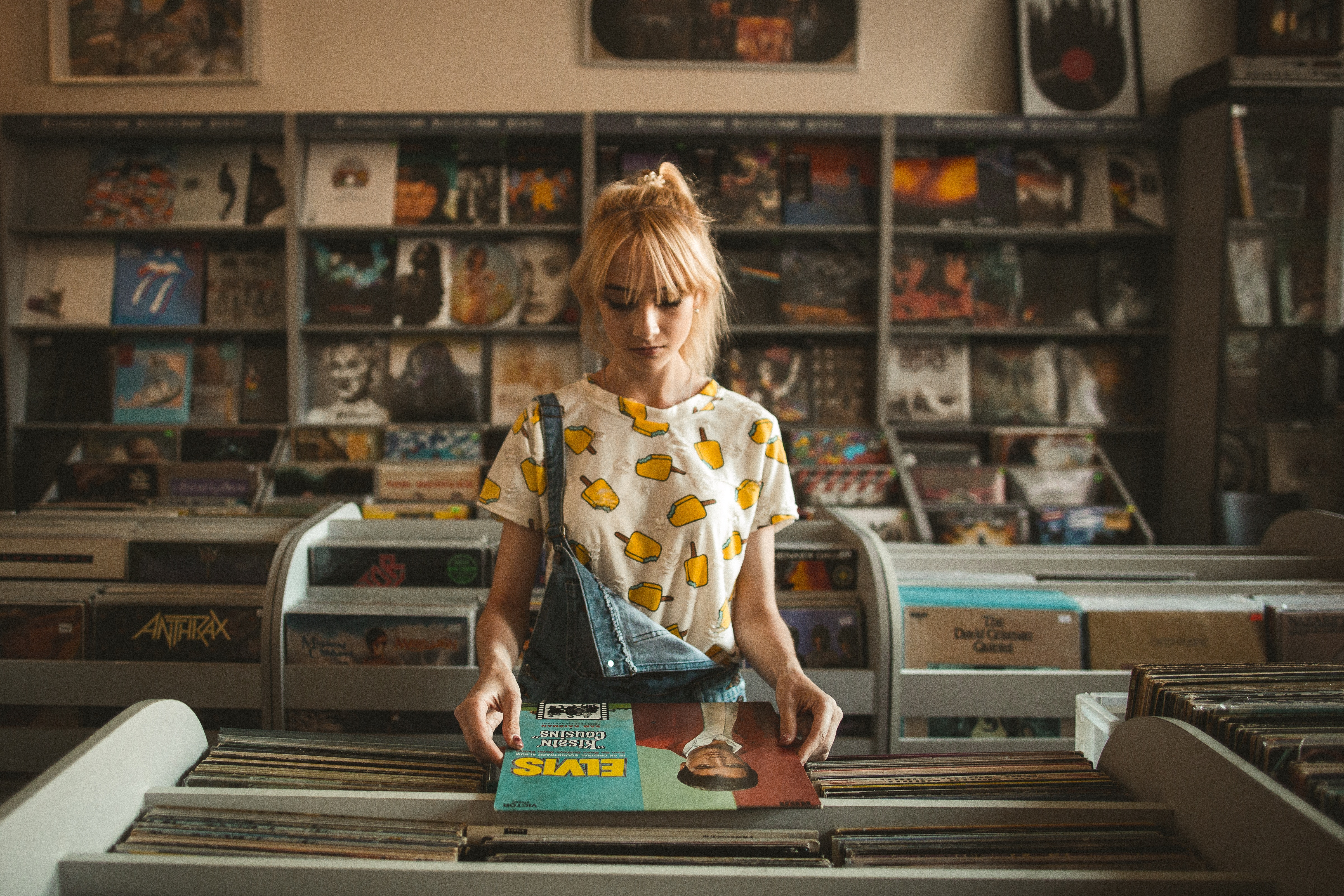 girl looking through records