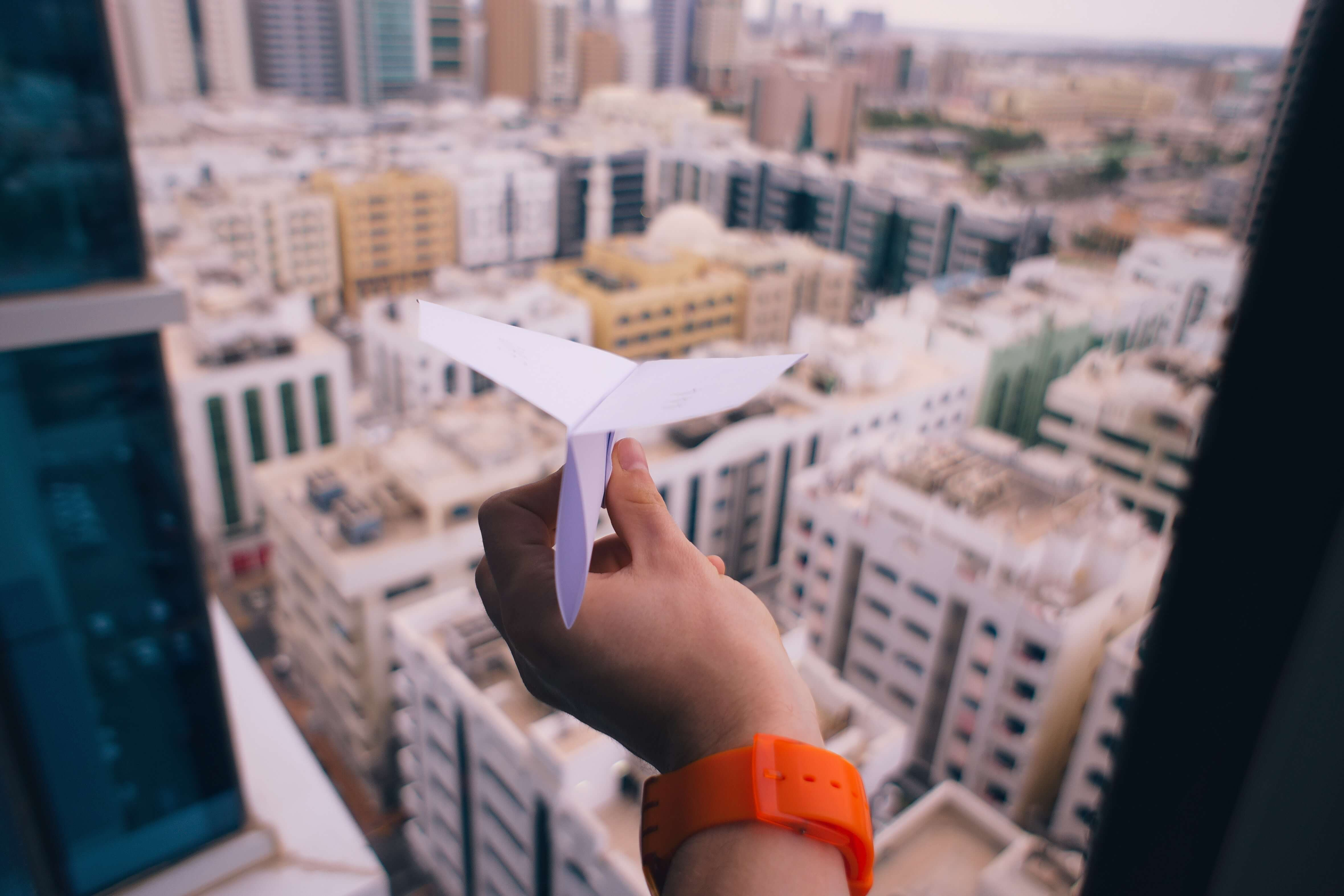 hand holding a paper airplane
