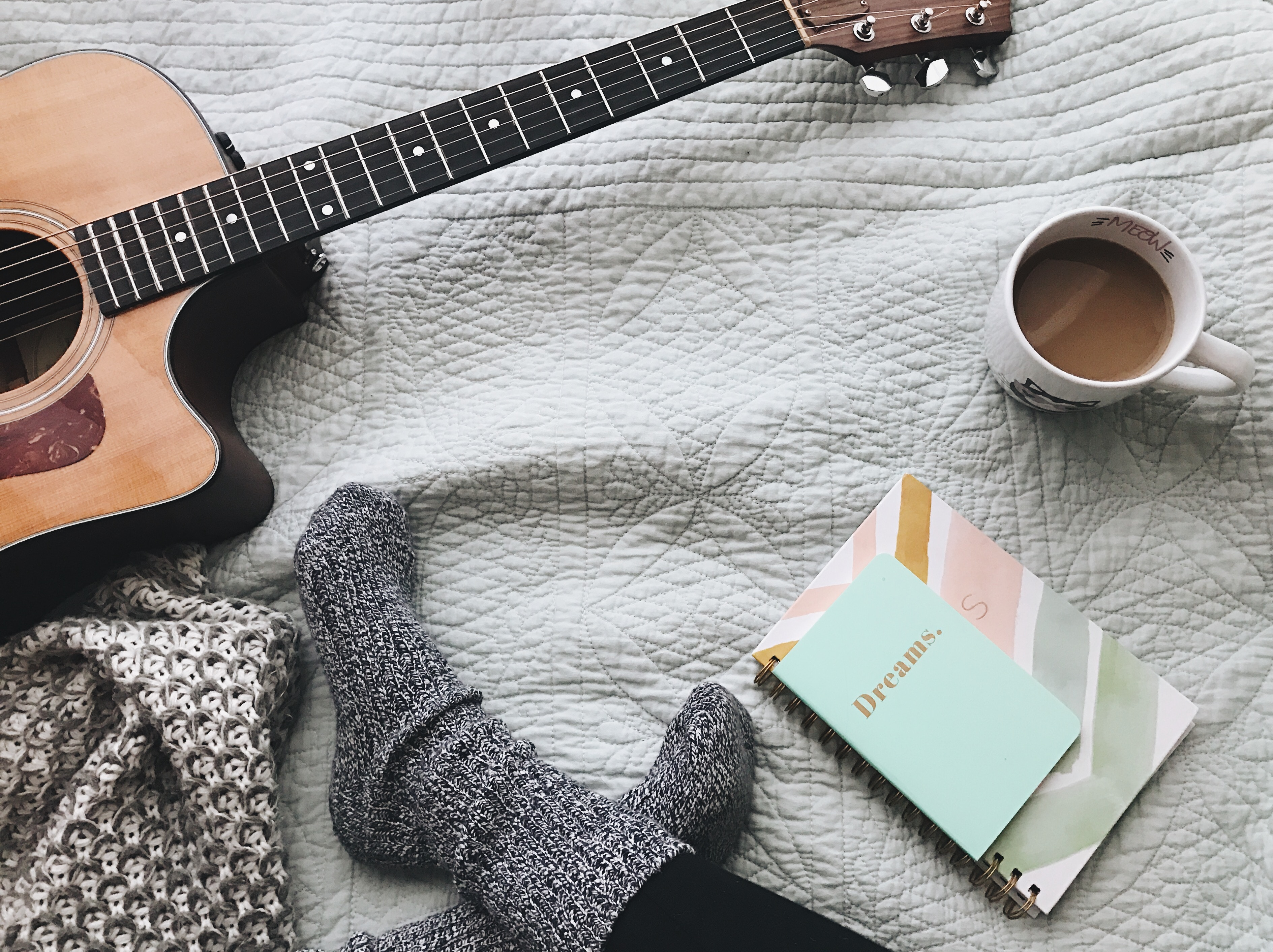 comfortable environment - guitar, coffee, notebook