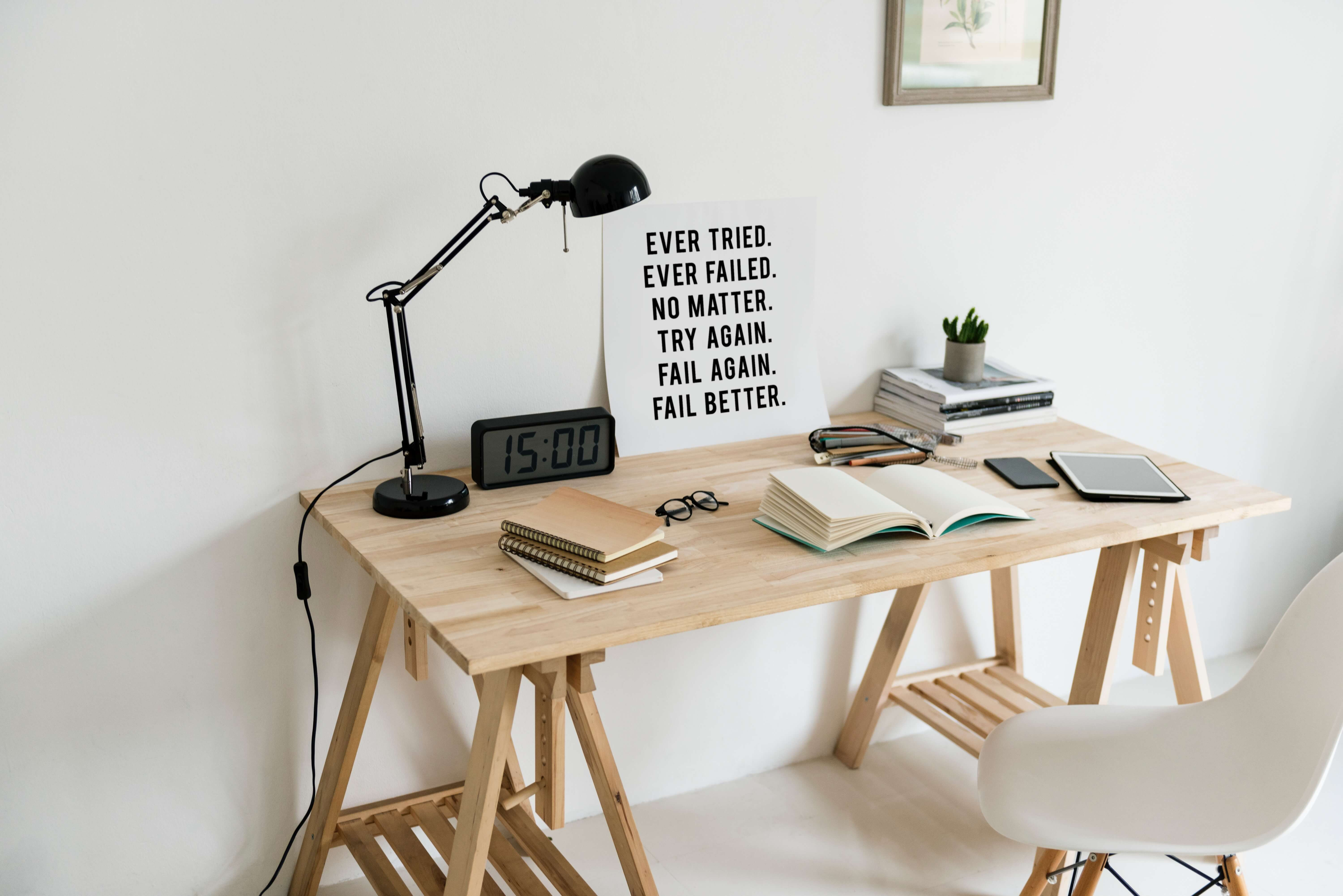 neat desk with a motivational print