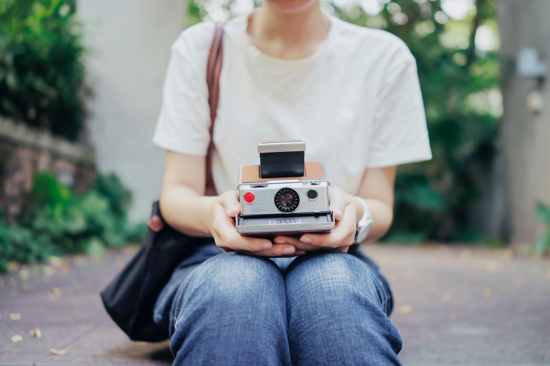 girl holding a polaroid