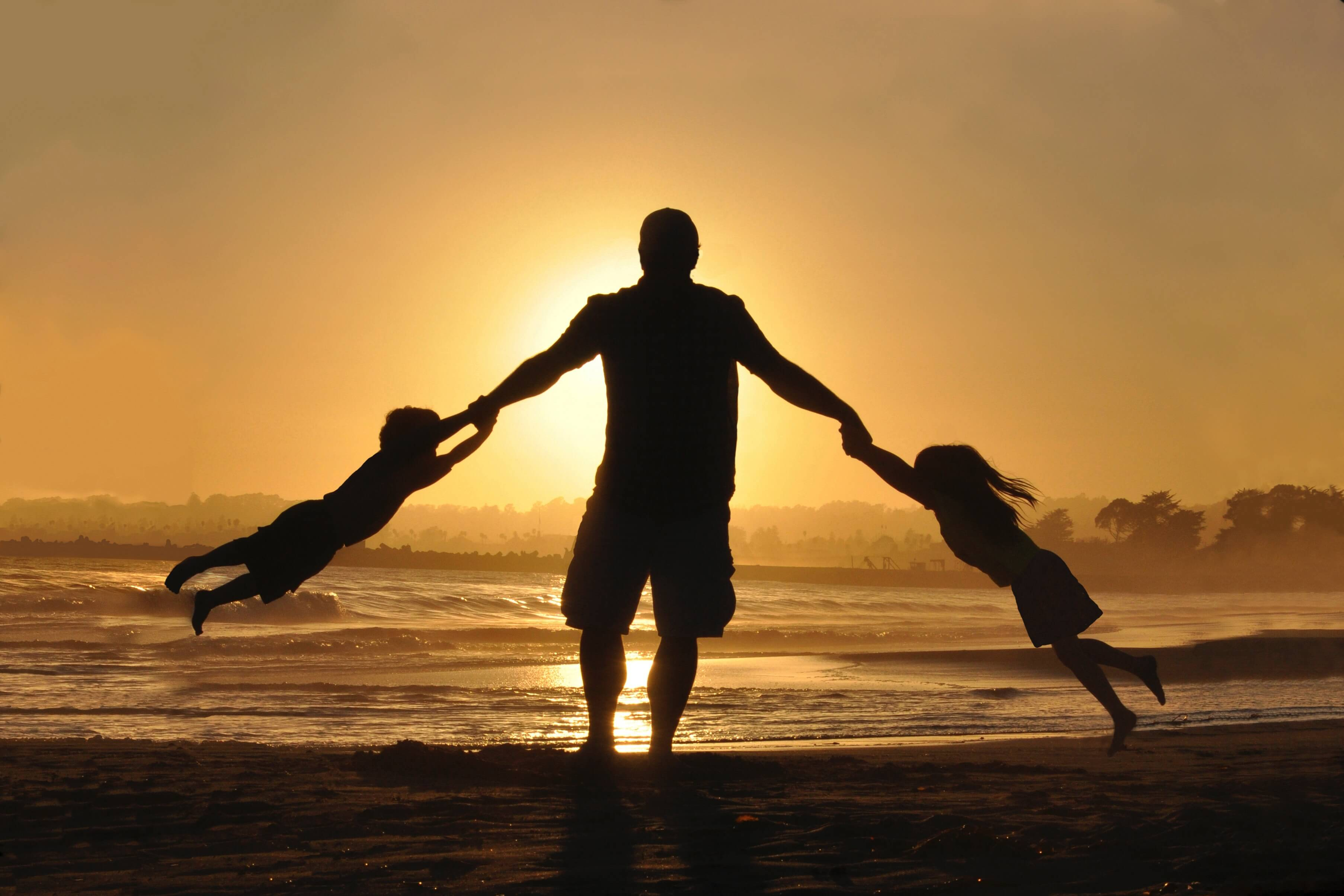 family having fun at sunset