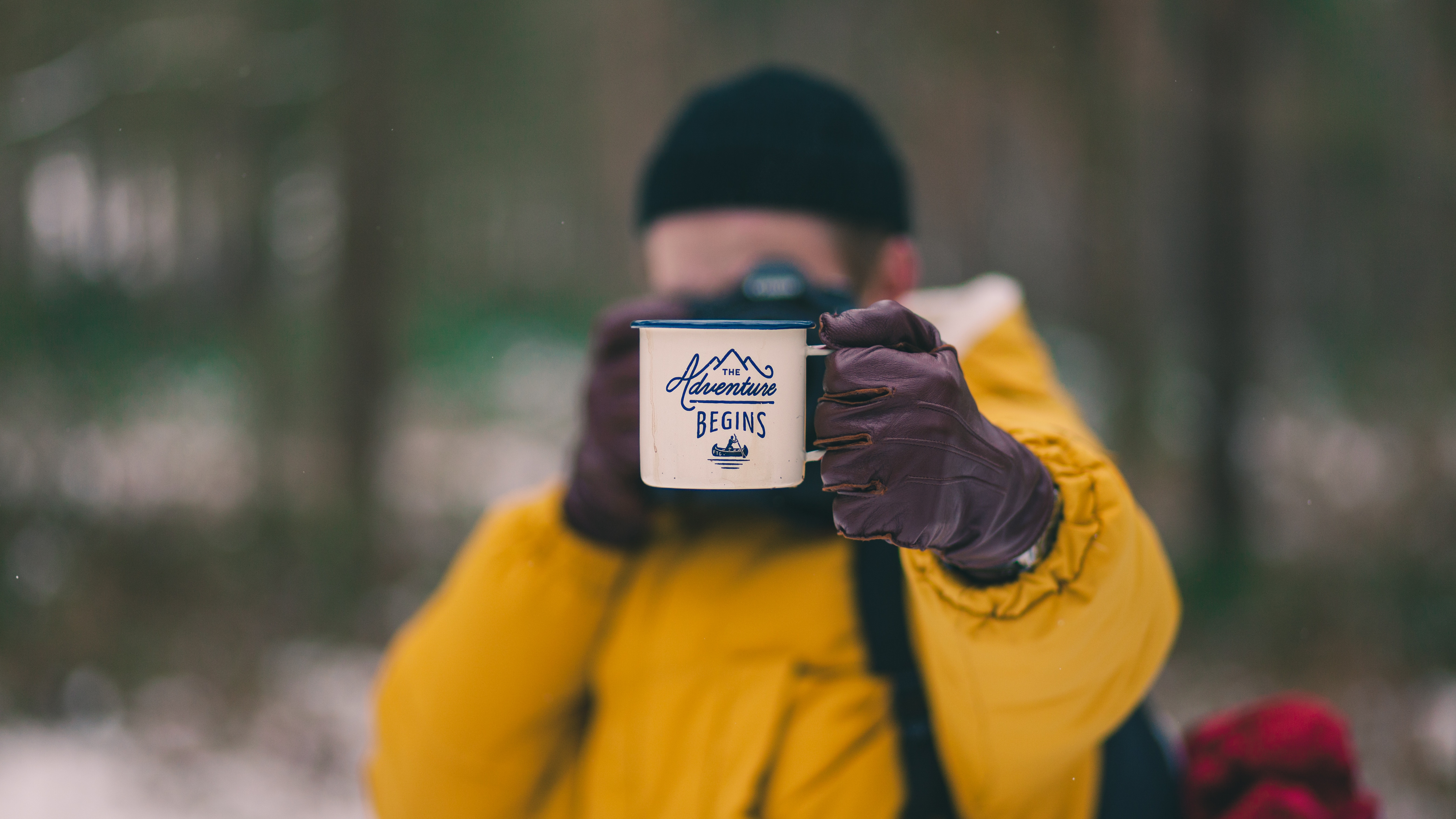 photographer holding an adventure cup