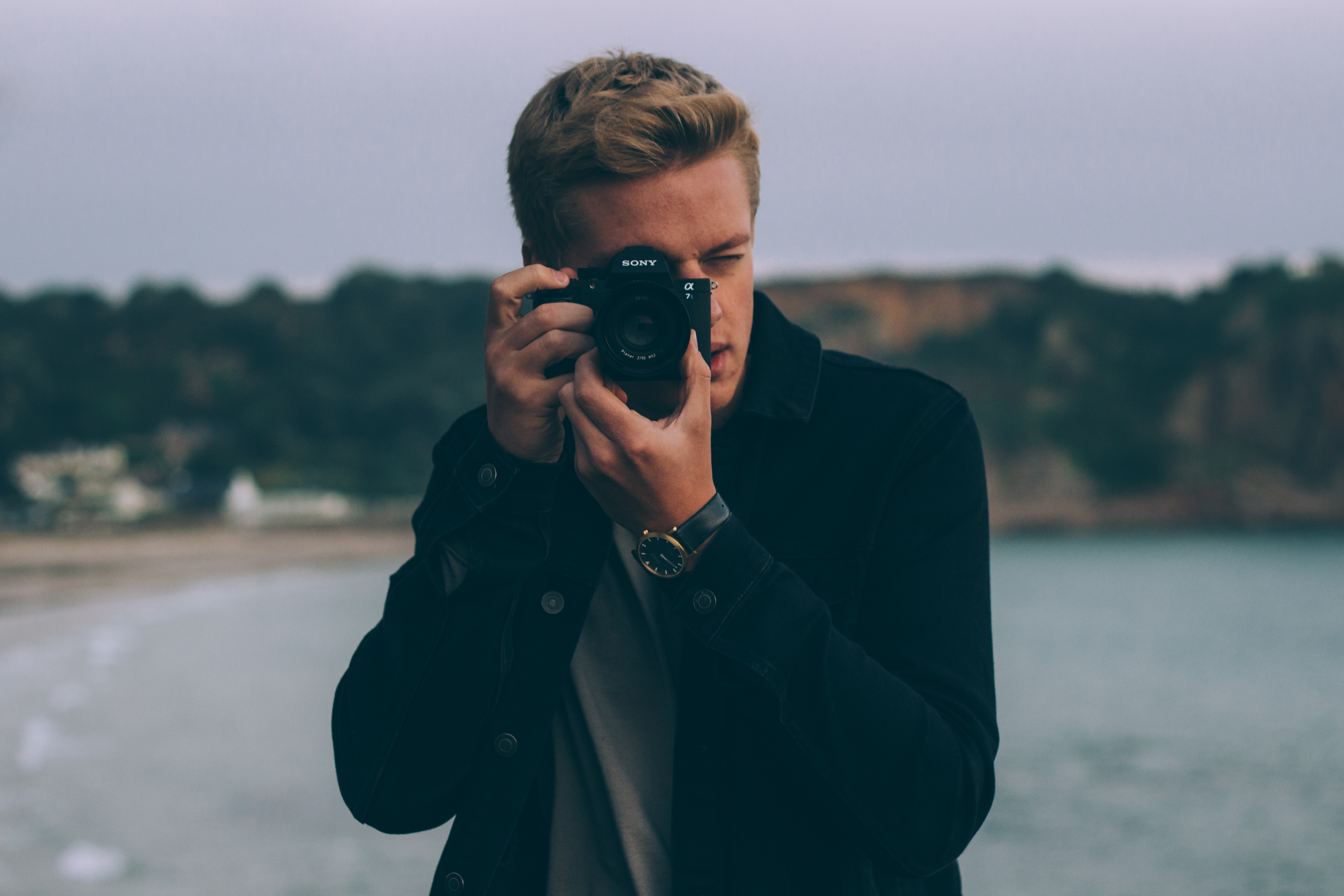 teenage boy holding a camera