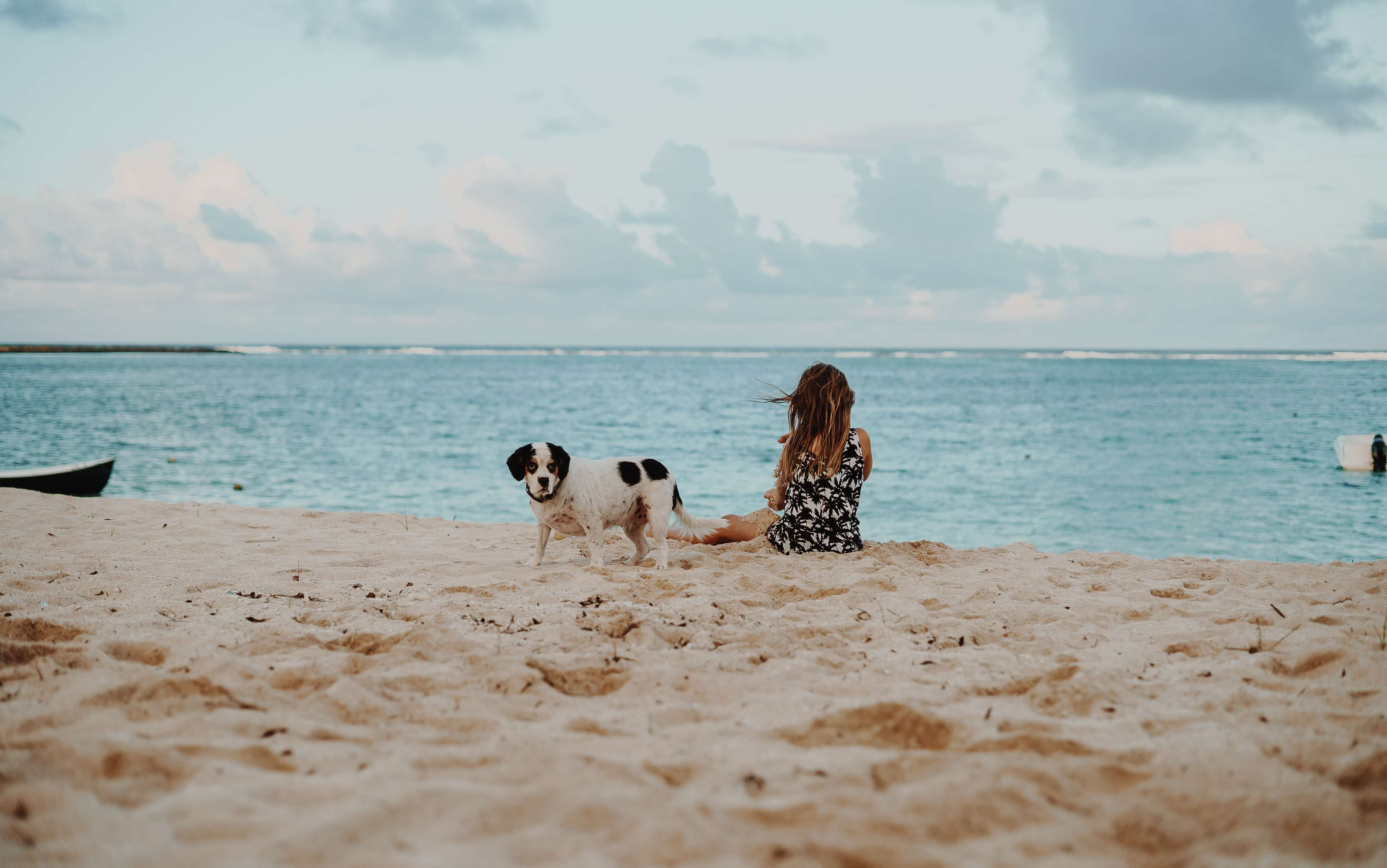 girl on the beach with her dog